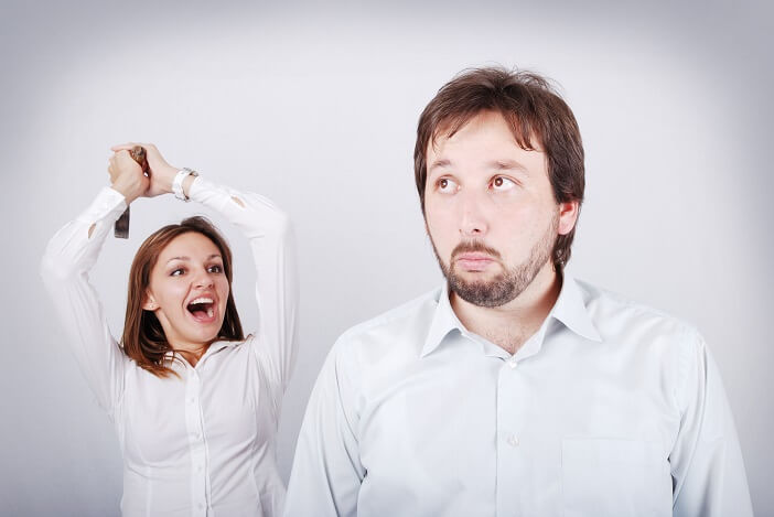 A woman angry with a confused forgetful man