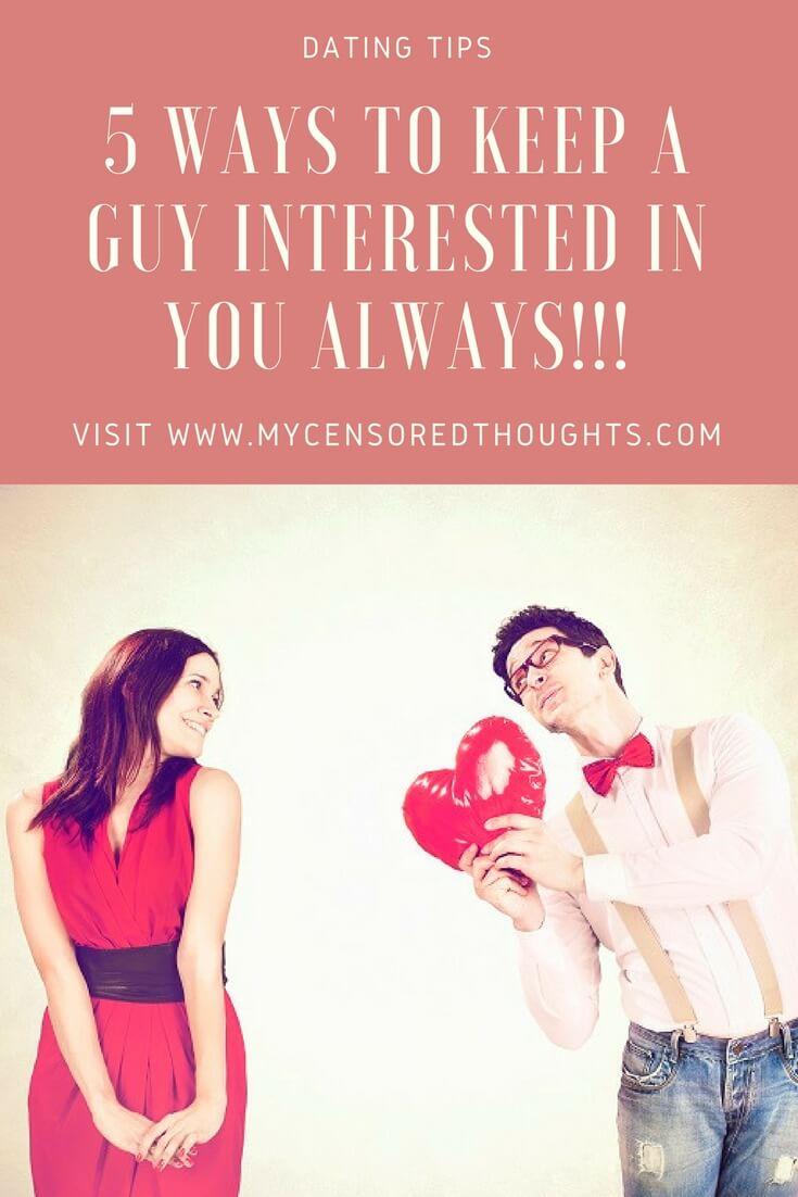 A man holding a heart balloon for a woman