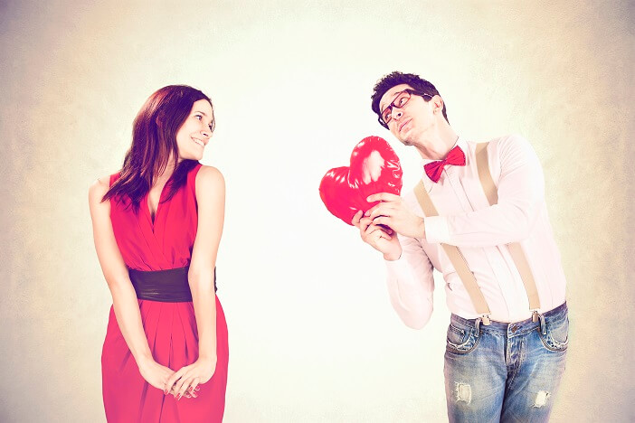 Illustration is portraying how to keep your man interested- A man holding a heart balloon for a woman.